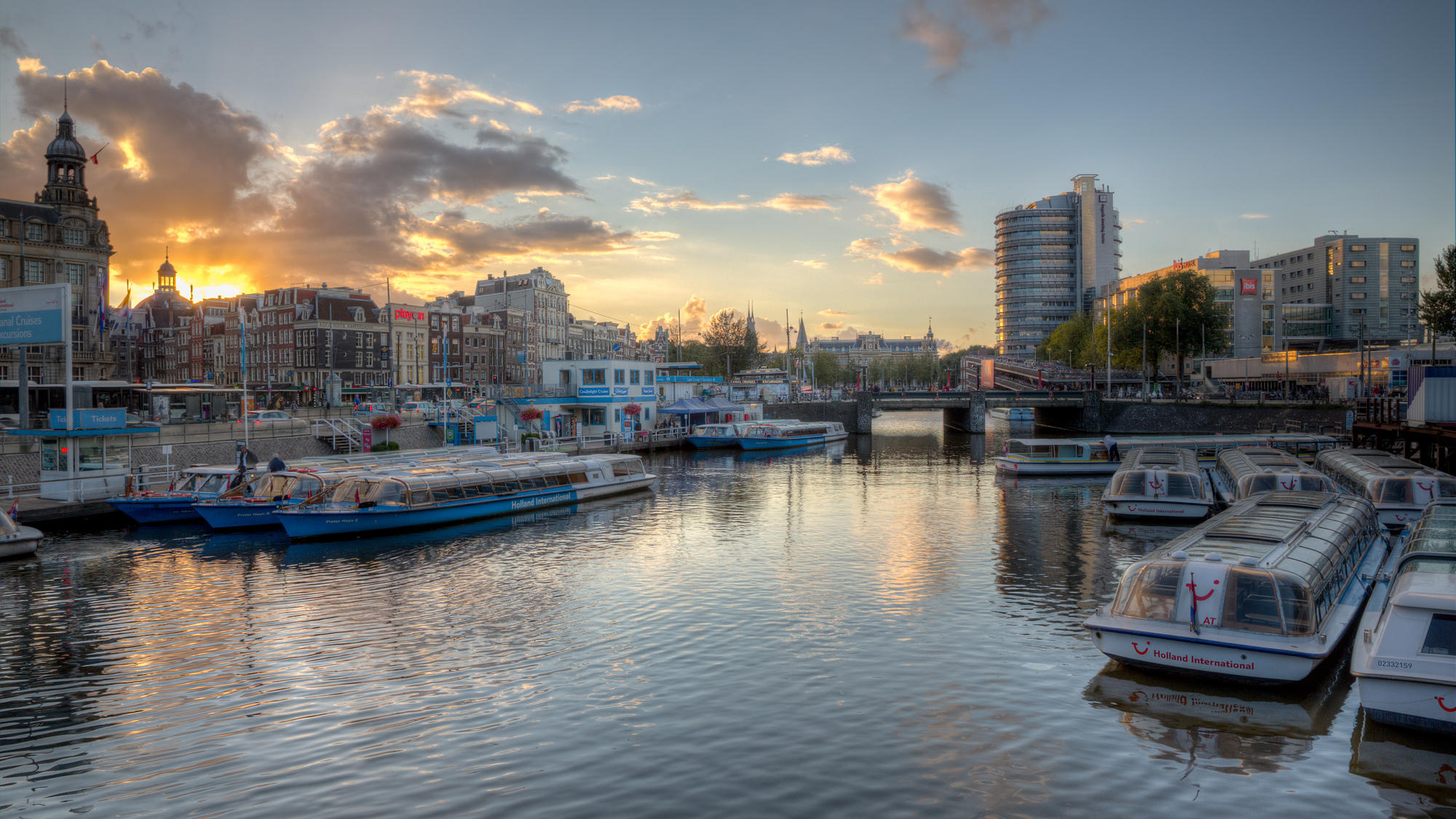 Beautiful photo of a nice sunset shot at a channel near Amsterdam Centraal
